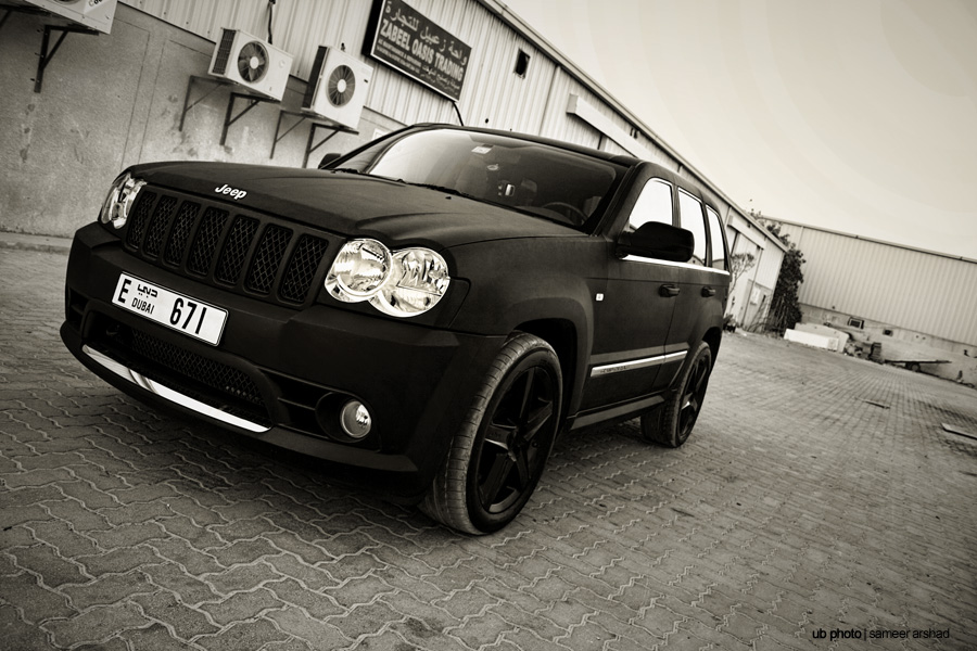 2009 Jeep GC SRT8--Brilliant Black. All options.